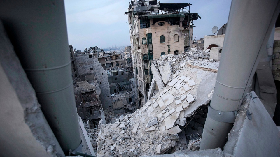 Destroyed buildings, including Dar Al-Shifa hospital are seen after airstrikes targeted the area last week in Aleppo, Syria Thursday, Nov. 29, 2012. (AP / Narciso Contreras)