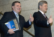 Finance Minister Jim Flaherty and Prime Minister Stephen Harper give a thumbs-up as they arrive to the House of Commons to deliver the federal budget in Ottawa on Tuesday, Feb. 26, 2008. (Tom Hanson / THE CANADIAN PRESS)