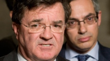 Minister of Finance Jim Flaherty and Minister of Industry Tony Clement speak with the media following Question Period outside the House of Commons on Parliament Hill in Ottawa, Wednesday November 17, 2010. (Adrian Wyld / THE CANADIAN PRESS)