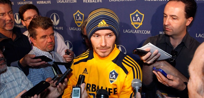 Los Angeles Galaxy's David Beckham, center, of England, talks with reporters during a news conference in Carson, Calif., Tuesday, Nov. 20, 2012. (AP / Alex Gallardo)