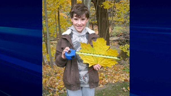 Joseph Donato, nine, shows off the world's largest maple leaf.