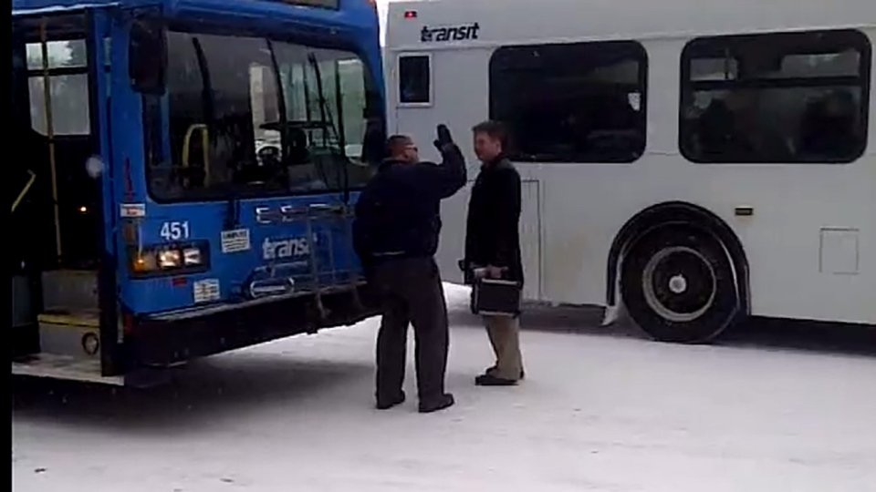 This screen shot from a video posted to YouTube shows an argument between a Saskatchewan bus driver and a pedestrian that took place on Thursday, Nov. 29, 2012.