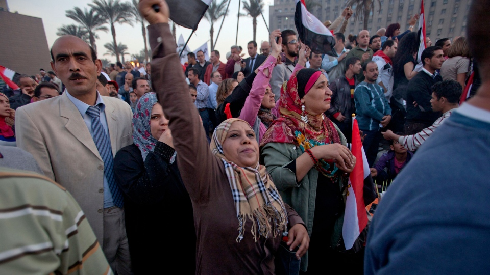 Demonstrators chant slogans and wave Egyptian flags in Tahrir Square where liberal and secular parties are holding major protests against Egyptian President Mohammed Morsi's latest decrees granting himself almost complete powers and allowing a rushed constitution to be presented for a vote, Friday, Nov. 30, 2012. (AP / Thomas Hartwell)
