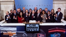 In this photo provided by the New York Stock Exchange, General Motors CEO Daniel Akerson, centre, rings the NYSE opening bell with other GM executives Thursday, Nov. 18, 2010.