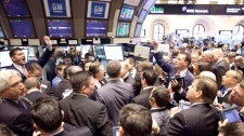 Stock traders bid on GM shares at the New York Stock Exchange during the GM initial public offering, Thursday, Nov. 18, 2010 in New York. (AP / Mark Lennihan)