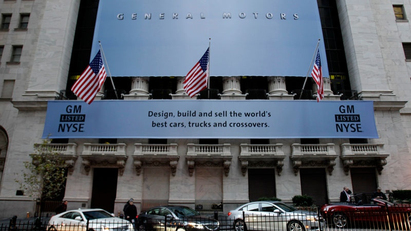 General Motors' cars are lined up in front of the New York Stock Exchange in New York, Thursday, Nov. 18, 2010. (AP / Seth Wenig)