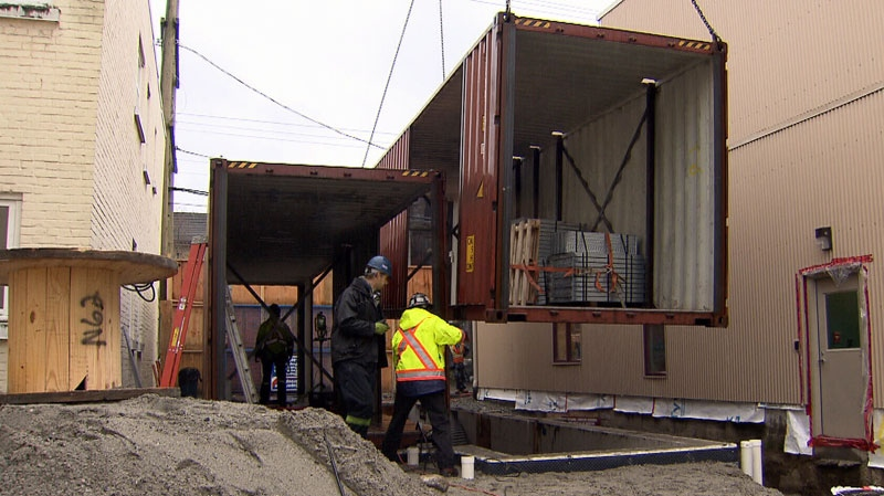 Crews work at converting a dozen shipping containers into social housing in Vancouver, B.C. Nov. 30, 2012. (CTV)