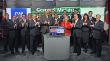 Kevin Williams, president and managing director, General Motors of Canada Ltd., Carol Stephenson, dean, Ivey School of Business and member of the General Motors Company Board of Directors, and Ken Lewenza, president of the Canadian Auto Workers, joined Tom Kloet, CEO, TMX Group to open trading on Toronto Stock Exchange, Thursday, Nov. 18, 2010.