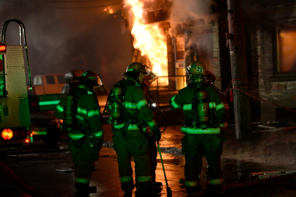 Firefighters battle a blaze in Montreal's East end on Friday, Nov. 30, 2012. (Ryan Remiorz / THE CANADIAN PRESS)