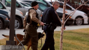 A Natrona County Sheriff's canine handler arrives at the scene of a reported homicide at Casper College in Casper, Wyoming on Friday, Nov. 30, 2012. (Casper Star-Tribune, Alan Rogers)