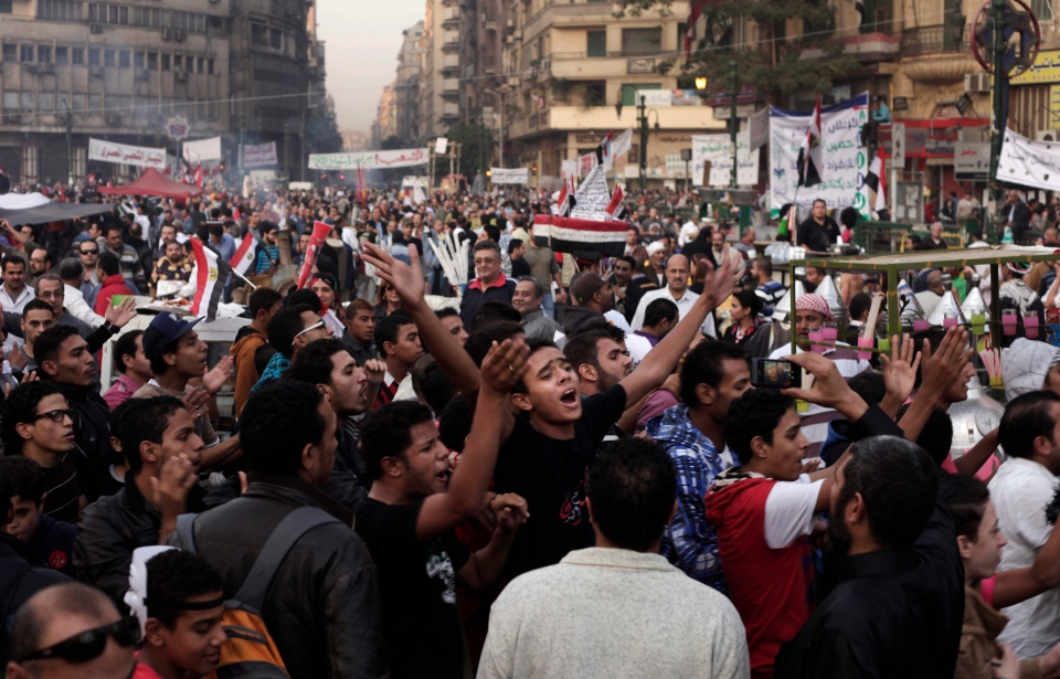 Egyptians chant slogans during a demonstration in Tahrir Square, Cairo, Egypt, Friday, Nov. 30, 2012.  (AP / Nariman El-Mofty)
