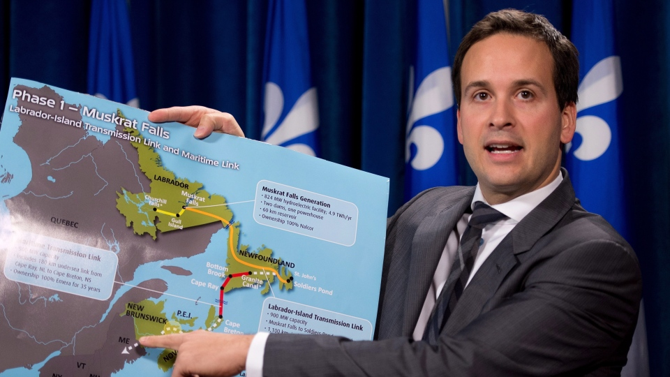 Alexandre Cloutier, junior minister for Canadian Intergovernmental Affairs, holds the Muskrat Falls/Churchill Falls project map as he criticizes the involvement of the federal government in a provincial jurisdiction at the legislature in Quebec City, Friday, Nov. 30, 2012. (Jacques Boissinot / THE CANADIAN PRESS)