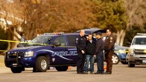Police investigate the scene of a homicide in front of a house on Hawthorne Ave. in Casper, Wyo. on Friday, Nov. 30, 2012. (Dan Cepeda, Casper Star-Tribune)