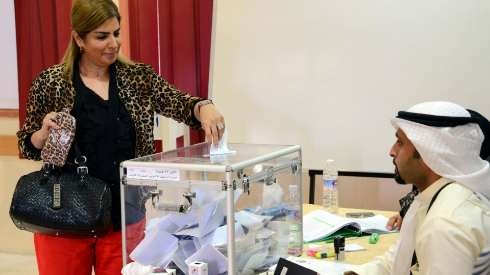 A Kuwaiti citizen casts her vote at a polling station in Saalwa, Kuwait on Saturday, Dec. 1, 2012. (AP / Gustavo Ferrari)