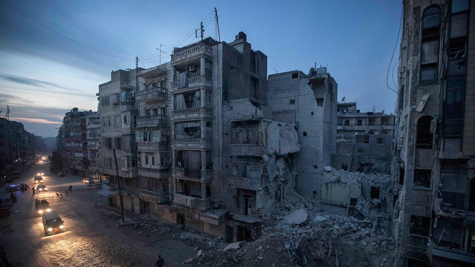 Night falls on a Syrian rebel-controlled area as destroyed buildings, including Dar Al-Shifa hospital, are seen on Sa'ar street after airstrikes targeted the area last week, killing dozens in Aleppo, Syria, Thursday, Nov. 29, 2012. (AP / Narciso Contreras)