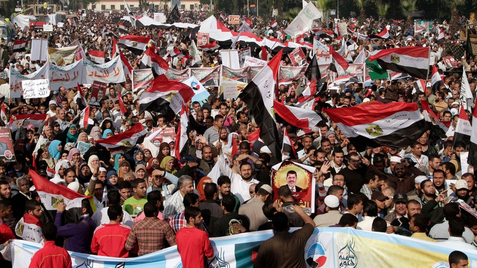Supporters of Egyptian President Mohammed Morsi attend a rally in front of Cairo University in Cairo, Egypt, Saturday, Dec. 1, 2012. (AP / Thomas Hartwell)