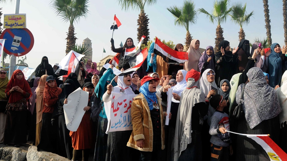 Supporters of Egyptian President Mohammed Morsi rally in front of Cairo University, Cairo, Egypt, Saturday, Dec. 1, 2012. (AP / Mohammed Asad)