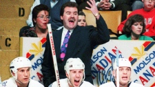 Toronto Maple Leafs' coach Pat Burns yells out instructions to his players on the ice during the second period of an NHL game against the Los Angeles Kings in Toronto on March 31, 1993. (THE CANADIAN PRESS)