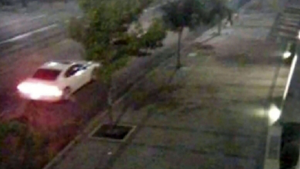 Police released video of a white Dodge Charger they believed was connected to the murder.