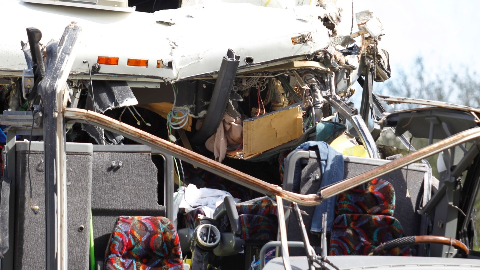 The front section of a bus that hit a concrete overpass at Miami International Airport is shown Saturday, Dec. 1, 2012 in Miami. (AP / Wilfredo Lee)