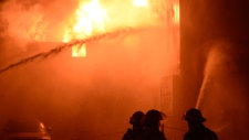 Firefighter battle a blaze in Montreal