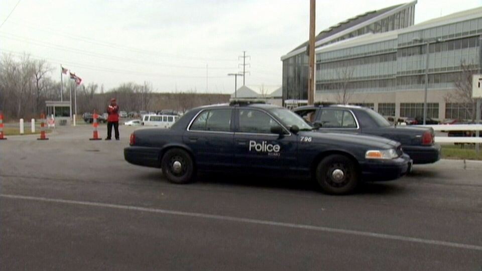 Police are seen outside of the Arrowhead Stadium complex, Kansas City, Mo., Saturday, Dec. 1, 2012.