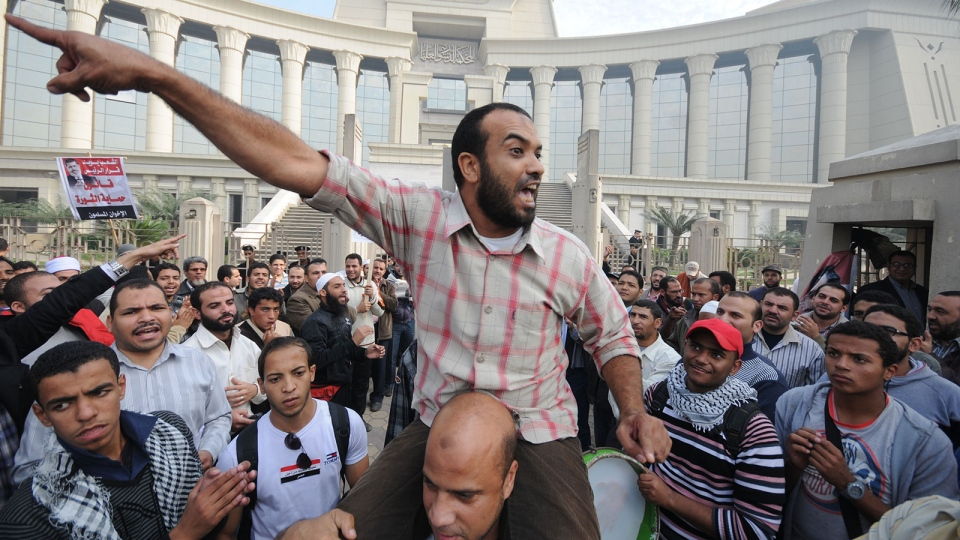 A demonstrator chants slogans as several thousand supporters of Islamist President Mohammed Morsi surround the Supreme Constitutional Court on Sunday, Dec. 2, 2012. (AP / Ahmad Hammad)
