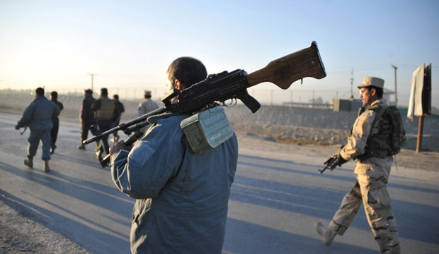 Afghan security forces patrol the site where Taliban suicide bombers attacked a joint U.S.-Afghan air base in Jalalabad, east of Kabul, Afghanistan, Sunday, Dec. 2, 2012. (AP Photo/Nasrullah Khan)