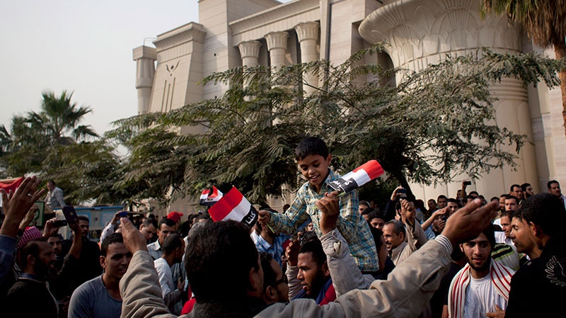 Supporters of Egyptian President Mohammed Morsi chant slogans in front of Egypt's top court, background, in Cairo, Egypt, Sunday, Dec. 2, 2012. (AP / Nasser Nasser)