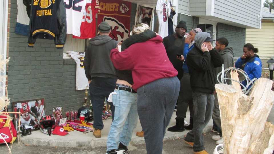 Friends and relatives of Kansas City Chiefs linebacker Jovan Belcher grieve outside the player's home on Dec. 1, 2012, in West Babylon, N.Y. (AP Photo/Frank Eltman)