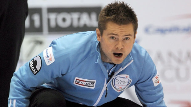 Winnipeg skip Mike McEwen studies the oncoming stone line during his 9-7 tie breaker win over Calgary's Kevin Koe in the Capital One Canada Cup Curling on Saturday. (Michael Burns / The Canadian Press)