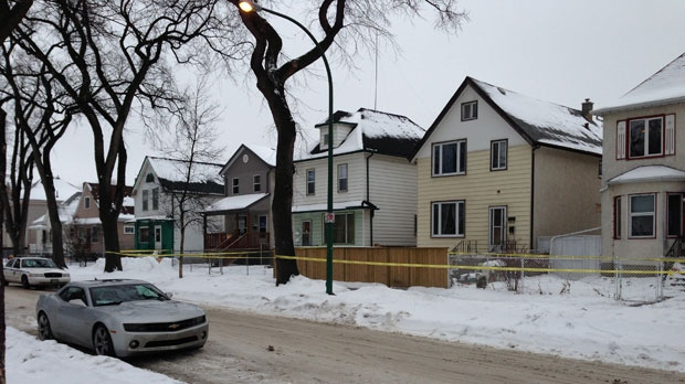 Winnipeg police taped off this area in the 400 block of Boyd Avenue after a double stabbing Sunday morning.