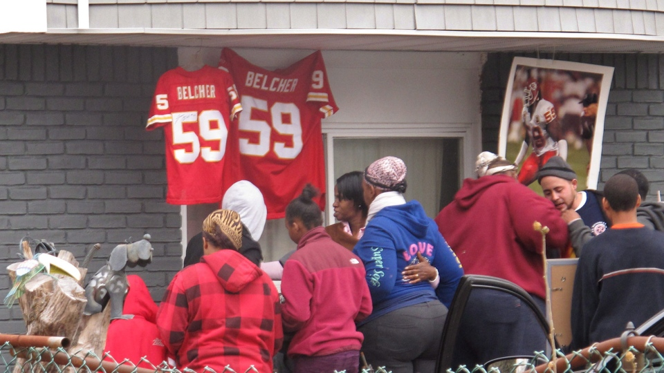 Friends and relatives of Kansas City Chiefs linebacker Jovan Belcher grieve outside the player's home  in West Babylon, N.Y. on Dec. 1, 2012. (AP / Frank Eltman)