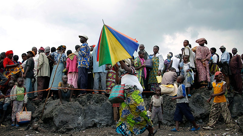Internally displaced Congolese wait for food to be distributed by WFP at the Mugunga 3 camp outside the eastern Congolese town of Goma Sunday Dec. 2, 2012. (AP / Jerome Delay)