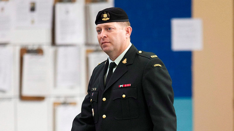 Maj. Darryl Watts (right) arrives for court martial proceedings in Calgary, Alberta on Wednesday, Nov. 14, 2012. (Larry MacDougal / THE CANADIAN PRESS)
