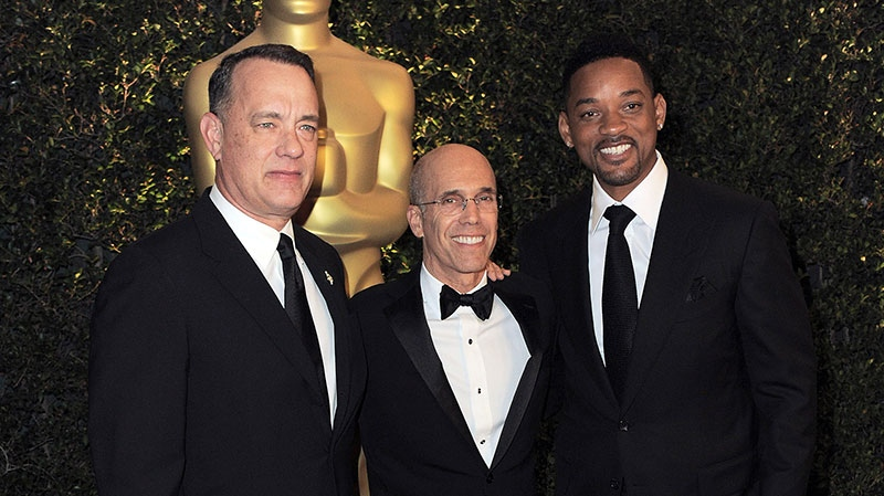 From left, Tom Hanks, Jeffrey Katzenberg and Will Smith arrive at the 4th Annual Governors Awards at Hollywood and Highland Center's Ray Dolby Ballroom on Saturday, Dec. 1, 2012, in Los Angeles. (Jordan Strauss / Invision)