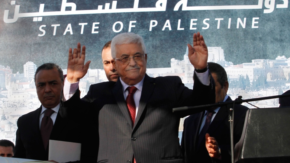 Palestinian President Mahmoud Abbas, waves to the crowd during celebrations for their successful bid to win U.N. statehood recognition in the West Bank city of Ramallah, Sunday, Dec. 2, 2012. (AP / Nasser Shiyoukhi)