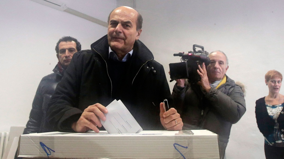 Pier Luigi Bersani, leader of the center-left Democratic Party, casts his vote during a primary runoff, in Piacenza, Italy, Sunday, Dec. 2, 2012. (AP / Antonio Calanni)
