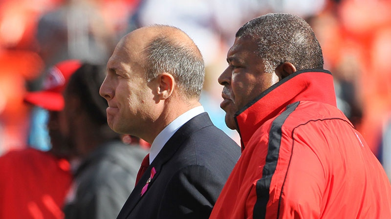 Kansas City Chiefs general manager Scott Pioli, left, and coach Romeo Crennel watch warmups before an NFL football game against the Carolina Panthers at Arrowhead Stadium in Kansas City, Mo., Sunday, Dec. 2, 2012. (AP / Colin E. Braley)
