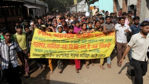 Garments workers of the Tazreen Fashions Ltd., shout slogans during a protest outside their factory in Dhaka, Bangladesh, Friday Nov. 29, 2012. (AP / Ashraful Alam Tito)