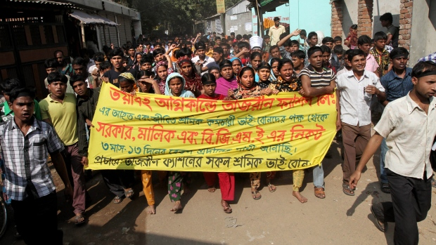 Bangladesh fire victims want old jobs back