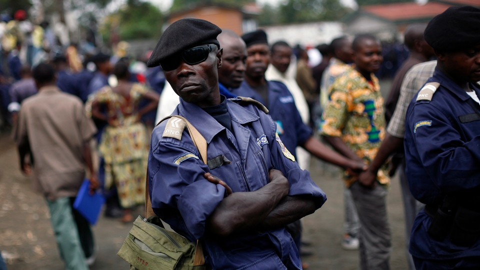 Police Nationale du Congo (PNC) officers gather at a stadium to be briefed by commanders, in Goma, eastern Congo, Monday Dec. 3, 2012. (AP / Jerome Delay)