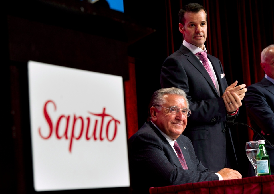 Saputo president and CEO Lino Saptuo Jr. and his father, Lino, chairman of the board, get set for the company's annual meeting in Laval, Que., in this July 2012 file photo. (Paul Chiasson/The Canadian Press)