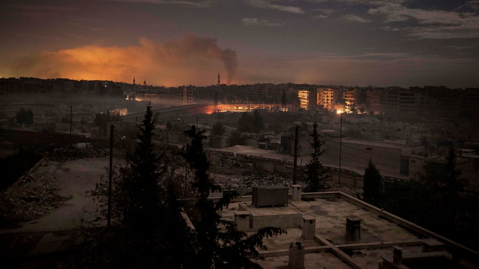 Smoke rises from buildings due to heavy fighting between Free Syrian Army fighters and government forces in Aleppo, Syria, on Dec. 1, 2012. (AP / Narciso Contreras)