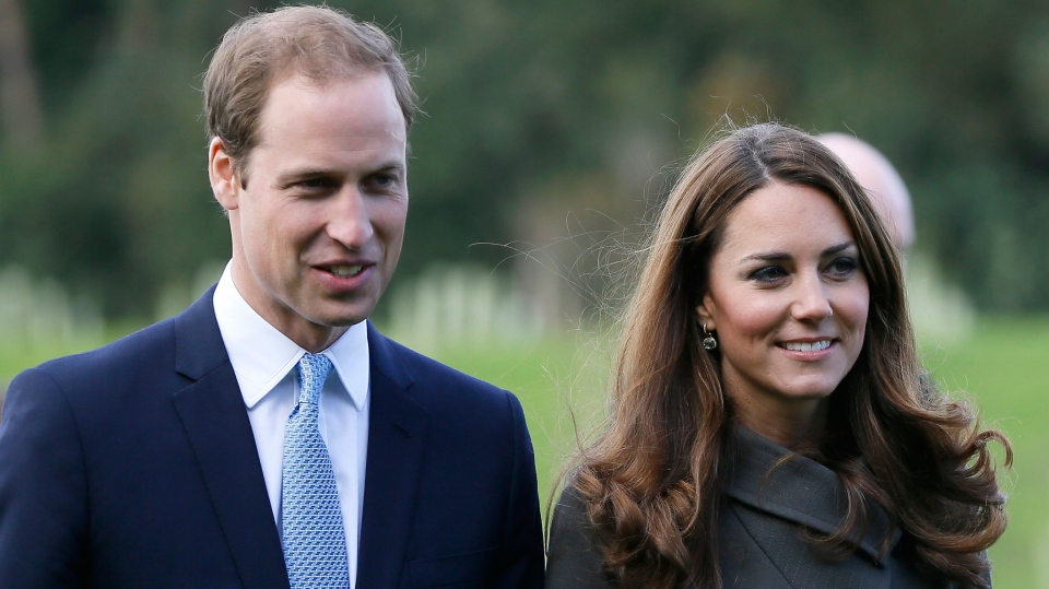 Britain's Prince William, left, and his wife Kate, the Duchess of Cambridge, visit a football training pitch at St George's Park near Burton Upon Trent in Staffordshire, England, Tuesday, Oct. 9, 2012. (AP / Kirsty Wigglesworth, FILE)
