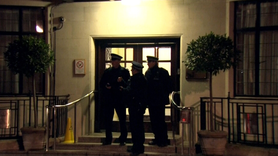 Police officers stand guard outside the King Edward VII hospital in central London where Kate will likely stay for several days to treat what palace officials call very acute morning sickness.