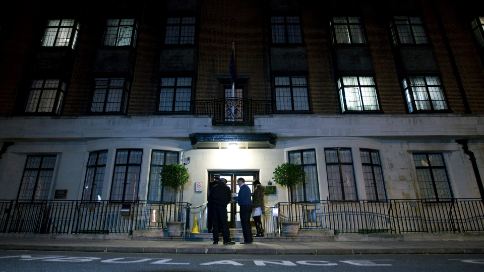Policemen stand guard outside London's King Edward VII hospital, where the Duchess of Cambridge had been admitted with a severe form of morning sickness. (AP / Alastair Grant)