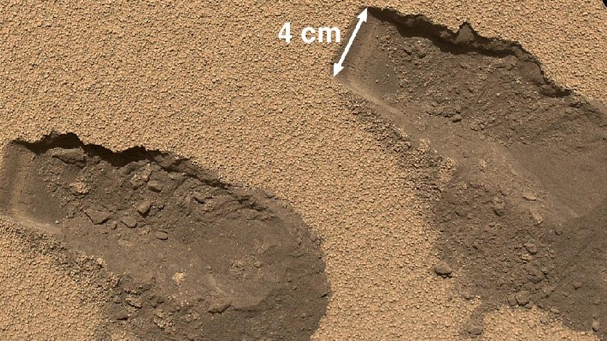 This is a view of the third (left) and fourth (right) trenches made by the 1.6-inch-wide (4-centimeter-wide) scoop on NASA's Mars rover Curiosity in October 2012. (NASA/JPL-Caltech/MSS)