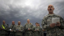 U.S. army soldiers sing hymns during Easter sunrise service in Camp Liberty, Baghdad, Iraq, Sunday, April 12, 2009. (AP Photo/Marko Drobnjakovic)