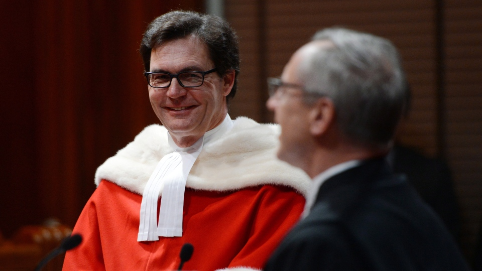 Justice Richard Wagner is sworn in by Roger Bilodeau, Registrar of the Supreme Court of Canada, during his official welcoming ceremony in Ottawa on Dec. 3, 2012. (Sean Kilpatrick / THE CANADIAN PRESS)